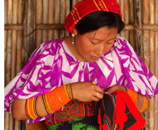 Kuna woman making a mola